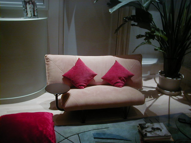 Suede sofa Chair with red sued pillows